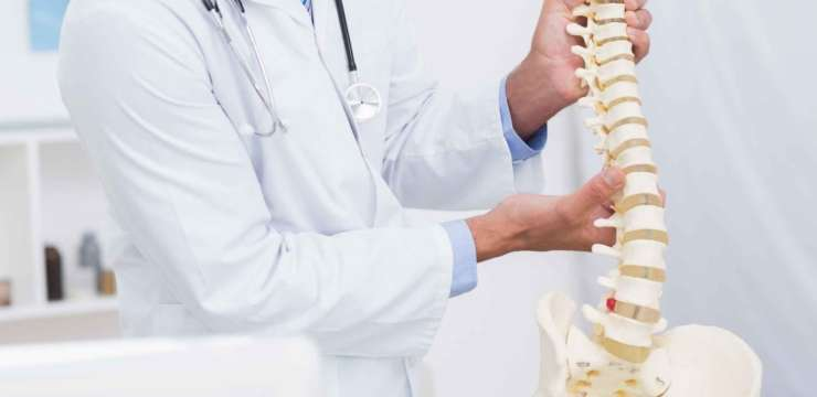 Image of a doctor demonstrating degenerative disc disease to a patient.