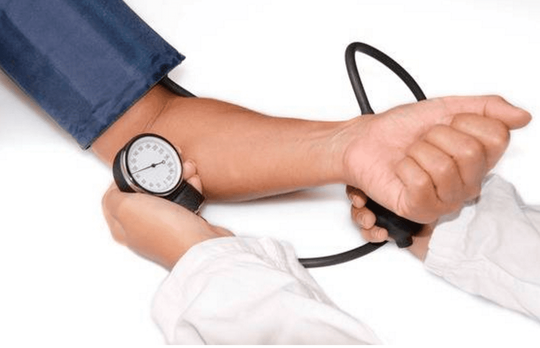 Doctor monitoring patient's vital signs